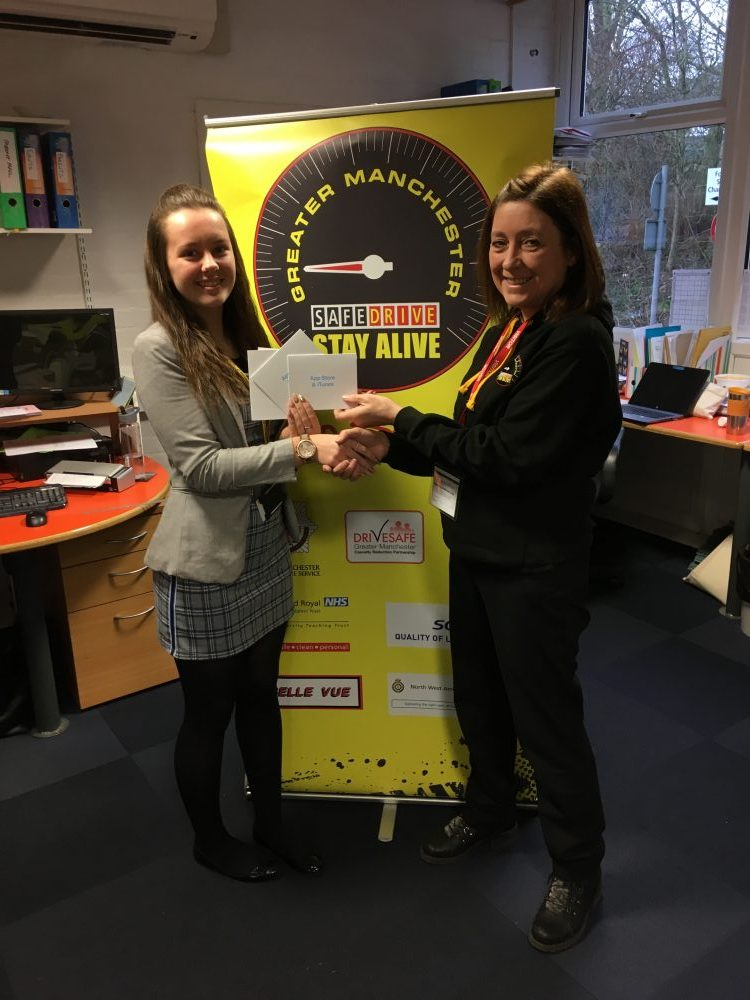 Neve Hurst presented with vouchers from Safe Drive GM Co-ordinator